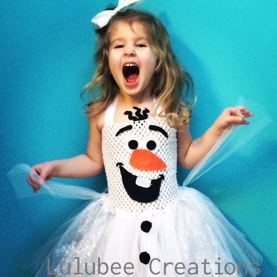 LINED Olaf Tutu Dress. This version has a lining of white fleece to keep your little ones warmer this fall season. Crochet top and a tulle skirt with a few sparkle tulle strips added. There are two ribbons that will tie behind your childs neck. The crochet top is very stretchy! So you will get lots of wear out of them ;)  XS: 6m - 18m. The top measures 6 in length and about the same for the skirt. Perfect for crawlers. ***No Olaf hair with this size. I think that it will bother the little…