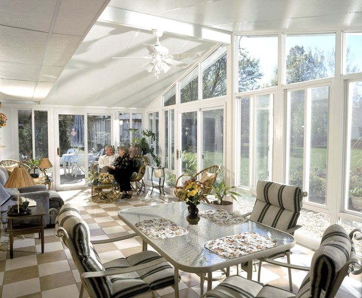 Exquisite White Sunroom Interior Design With Vintage Dining Set And Mini Flowers Centerpiece Blue Recliner Rattan Chairs Also Square Wood S