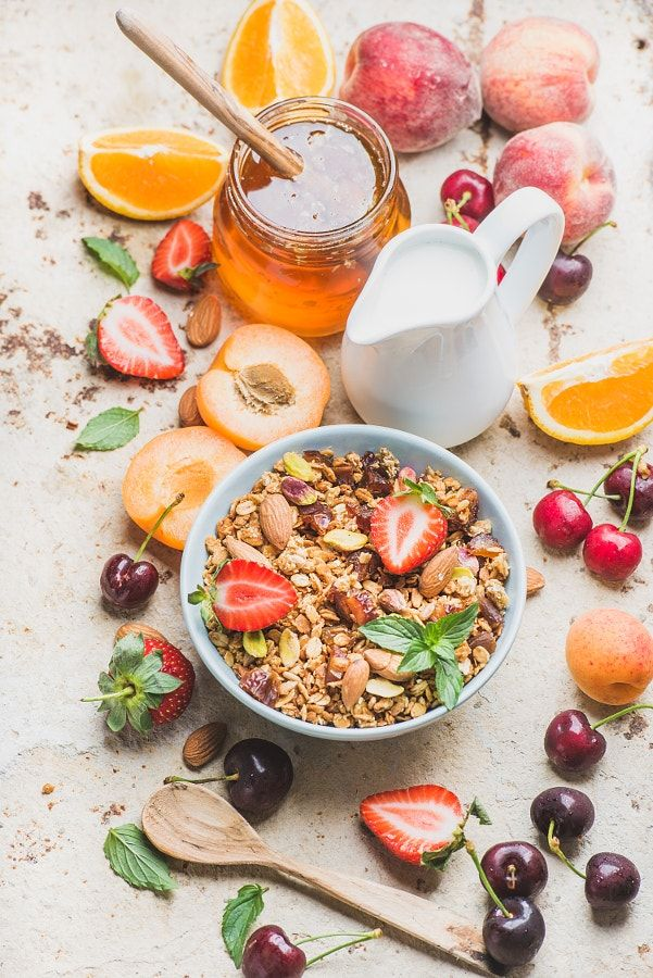 UOGoals: MAKE THIS! Healthy breakfast ingredients. Oat granola in bowl with nuts, strawberry and mint, milk in... by Anna Ivanova - Photo 163507735 / 500px