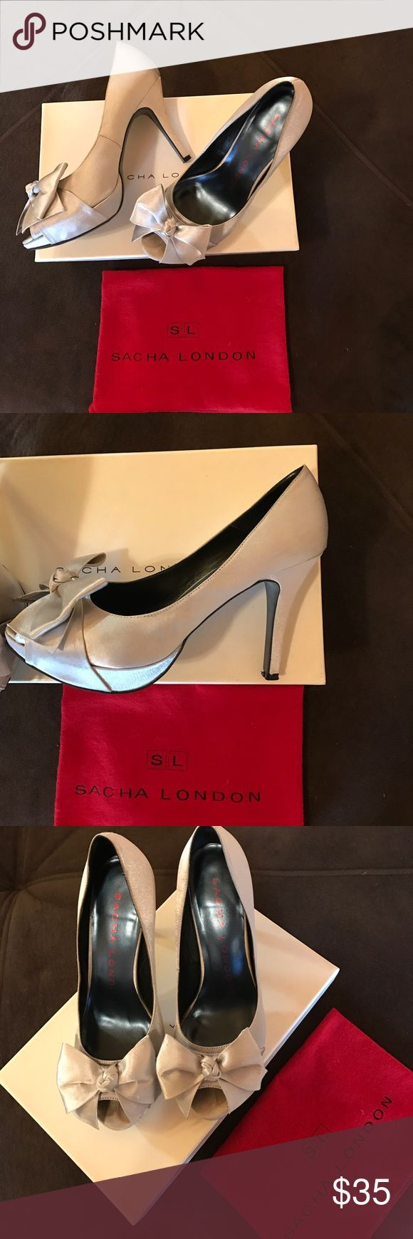 Sacha London Shoes size 7.5  silver with bow Sacha London heels size 7.5 silver with bow front. Satin material. Worn once for a wedding, scuffs on bottom of heels but overall in great condition. Sacha London Shoes Heels