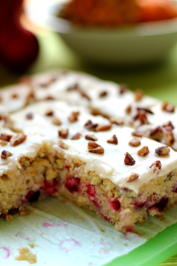 Cranberry Orange Pecan Cake Recipe--I love cranberries. I love oranges. I can tolerate pecans. I'm sure the sugary combination of these three are marvelous!
