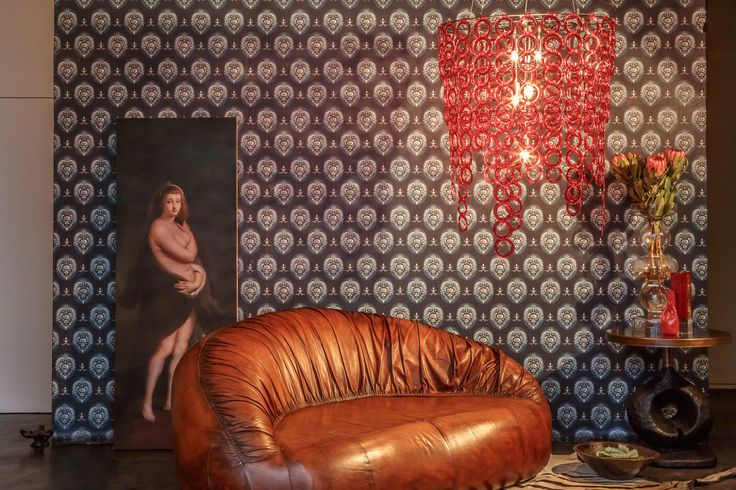 Sunset Surilight chandelier with retro leather sofa & dramatic wallpaper.