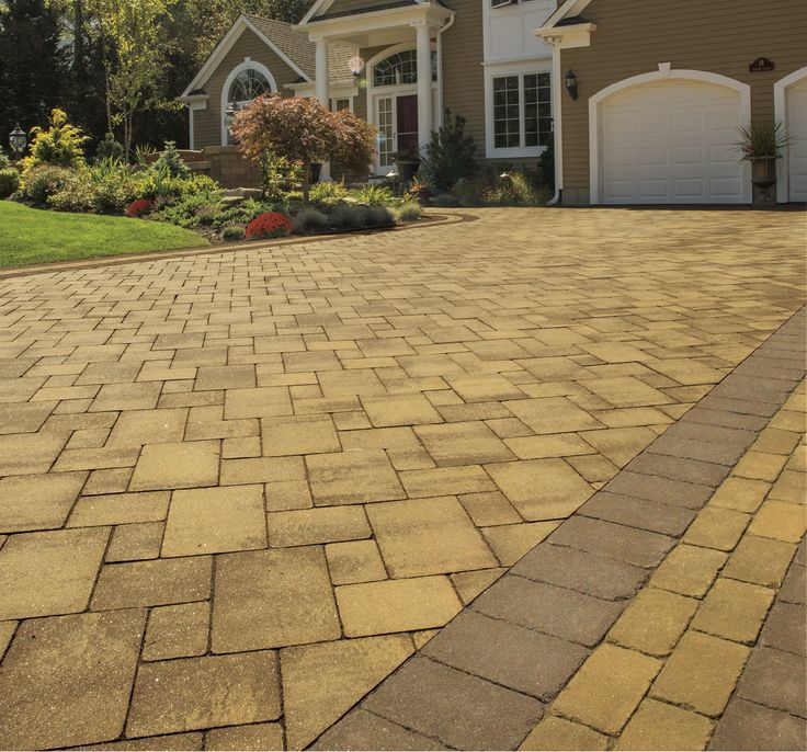 This amazing driveway was created using Cambridge's Renaissance Collection in Olde English Paver 3-Pc. Kit in Sahara/Chestnut with a border of 6x6 Sahara and 6x9 Chestnut.