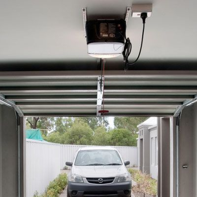 Best 25 garage door track ideas on pinterest garage for Garage door opens on its own