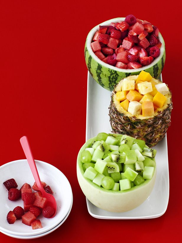 Step up your fruit salad this year by serving cubes of fruit in color-coordinated fruit bowls. Place honeydew, kiwi, green apples and grapes in a hollowed-out honeydew; pineapple, mango, papaya and banana in a pineapple shell; and raspberries, strawberries and watermelon in a small watermelon.
