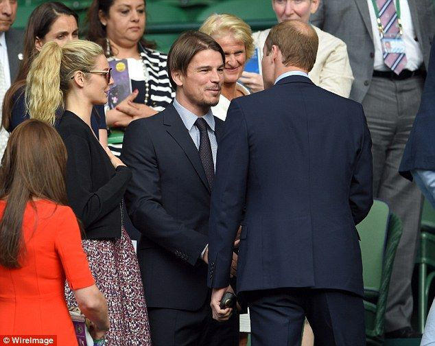 Josh and Prince William shook hands as the tennis game took a break, the two suit-clad men in deep conversation
