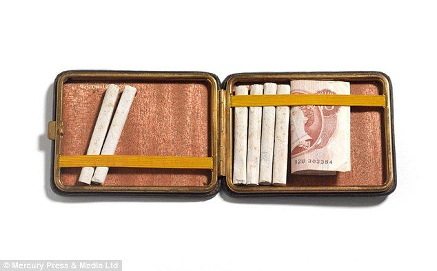 Ron Kray's cigarette case with money