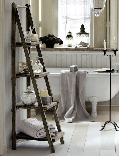 I love all the beautiful little decorative pieces that bring this room together. Especially the ladder and candle stand