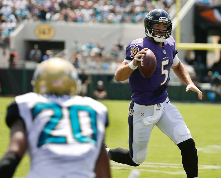 Baltimore Ravens quarterback Joe Flacco (5) rushes past Jacksonville Jaguars cornerback Jalen Ramsey (20) for a 7-yard touchdown run during the first half of an NFL football game in Jacksonville, Fla., Sunday, Sept. 25, 2016.