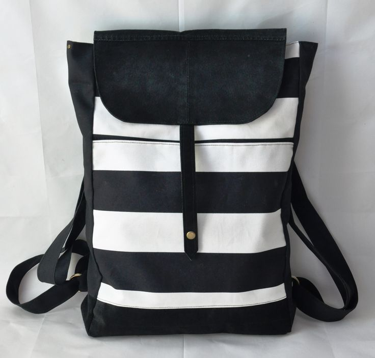 Black&white striped backpack combined with leather
