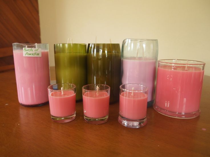 soy wax candles in wine bottles and coca cola bottle ..all recycled bottles