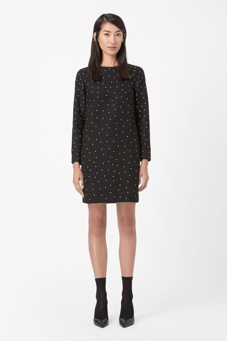 Made from structured wool-mix with a compact texture, this dress has a raised dotted detail. A straight shape, it is a boxy style with a simple round neckline, long sleeves and a hidden zip fastening along the back.