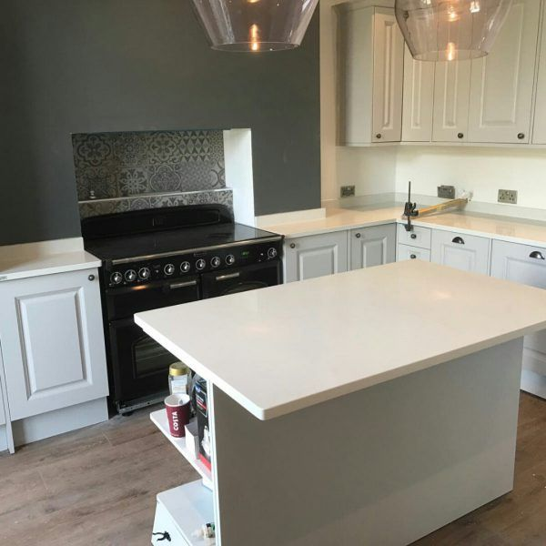 This ideal breakfast bar on the kitchen island has been finished off with the Bianco Carrina.