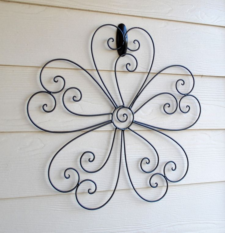 curly q wall hanging, used to be pink, spray painted it brown, hung with plastic outdoor command strip hook painted brown