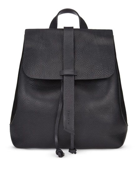 Handmade in a family-run factory in Portugal, the Blake Backpack is crafted from a supple leather that will age beautifully over time. With strong bridle leather for the adjustable straps and unlined for a natural finish, this piece is practical yet stylish. Other features include a leather drawstring closure, a press-stud closure and an interior purse to keep belongings safe.