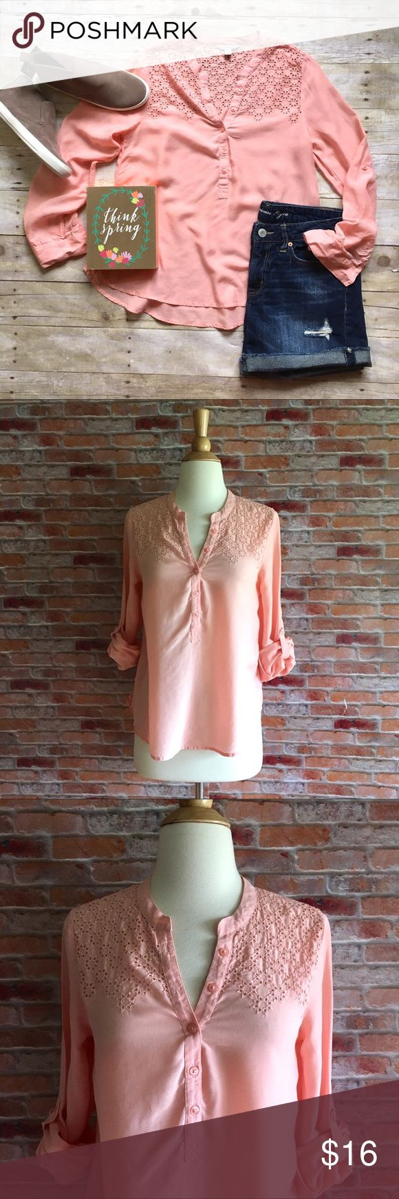 """American Eagle peachy pink eyelet panel top Peach lightweight top featuring 1/2 button front, eyelet top panel, and roll tab button sleeves. In excellent condition. 24""""L. 17"""" bust laying flat. Rayon. Size small. *shorts & blazer pictured are also for sale in my closet, buy the look and save! American Eagle Outfitters Tops"""