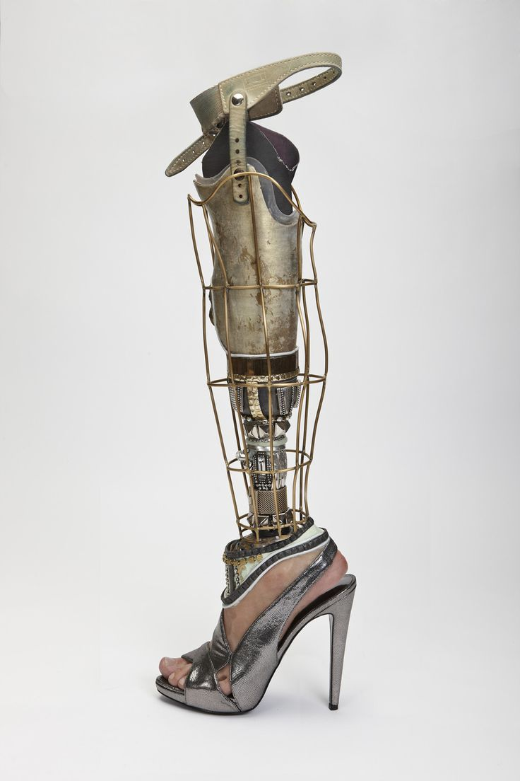 Retro futuristic leg for Viktoria Modesta designed and made by Sophie de Oliveira and James fitted at Proactive Prosthetics photographed by Nadav Kander and Omkaar Kotedia-  Alternative Limb Project