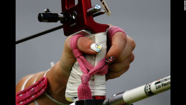 The festive nail polish of Great Britain's Amy Oliver stands out during the women's team archery elimination match between Britain and Russia. http://www.PaulFDavis.com/success-speaker (info@PaulFDavis.com)