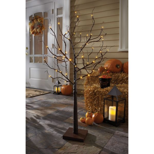 Add a touch of LED light to any Halloween display with the Order Home Collection Halloween LED Tree. Glowing with orange LED light, this gnarled tree features bare, flexible branches that can be bent