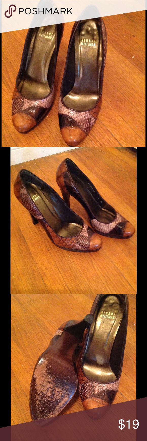 Shoes Stuart wiseman pumps. Well loved please look at the 3rd pic for the wear on the soles. Has a lot of life left in it. Please make an offer eager to sell Stuart Weitzman Shoes Heels