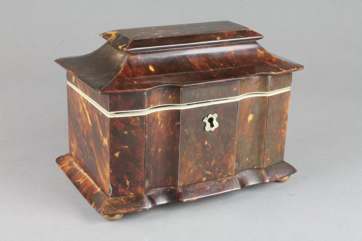 """Lot 830a, A 19th Century 2 division tortoiseshell tea caddy with ivory mounts of inverted serpentine form on bun feet 8"""", est  £300-600"""
