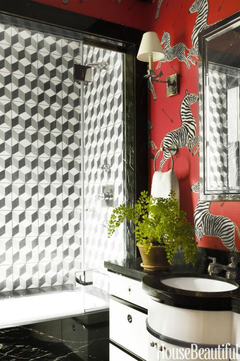 What's black and white and red all over? Daring wallpaper adorned with zebras. Add in black marble accents and a potted plant, as Miles Redd did in this one-of-a-kind bathroom, and you have an ultra-contemporary take on nature that's perfect for your kids' bathroom — or your own. Click through for more dream bathroom inspiration.