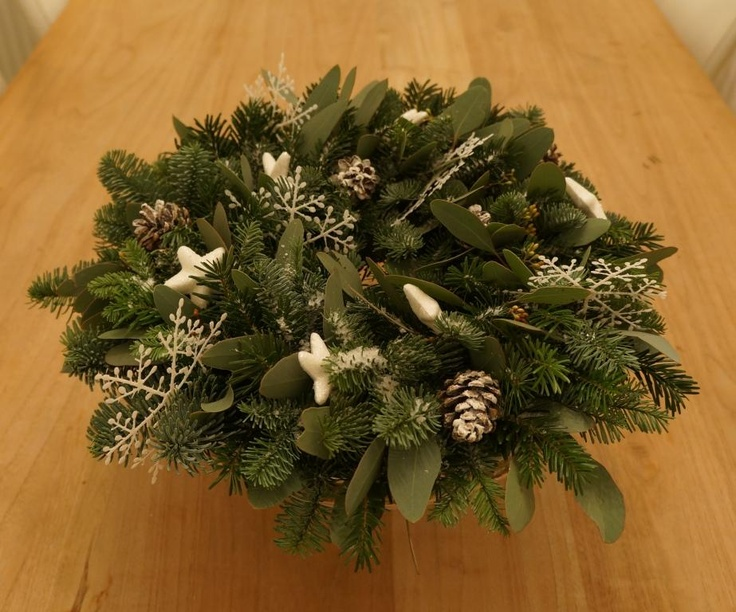 Nobilis branches, Eucalyptus, white ornamants and snowy pinecones: a lovely winter wreath!