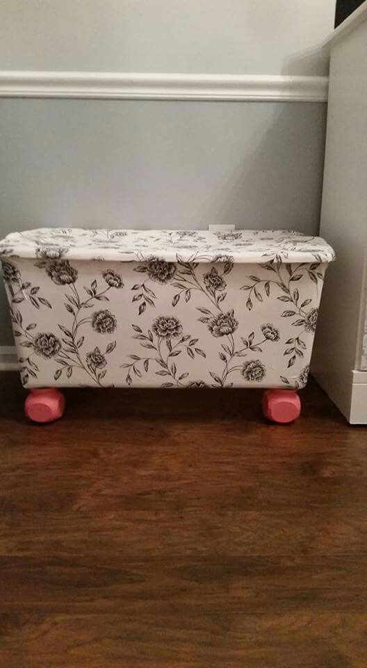 Needed a toy box. Wanted something pretty, needed something cheap. Used a Plastic tote box we had, cheap fabric from Walmart, spray adhesive, painted porch rail caps from Lowes and used them as feet.