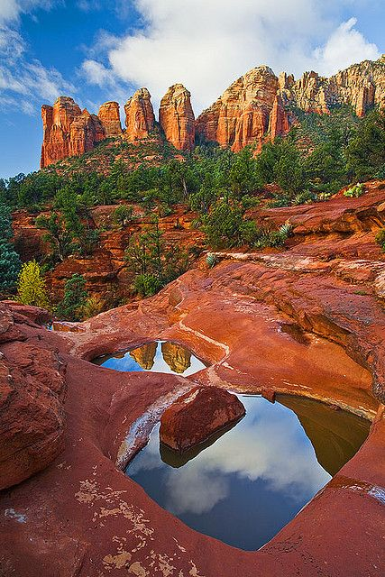 Two of the Seven Sacred Pools reflecting the red rock formations near Sedona, Arizona.