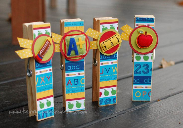 Teacher gifts!  First up is some jumbo clothespins, meant to use as a holder for photos, notes, reminders, etc.  school-themed paper  embellishments