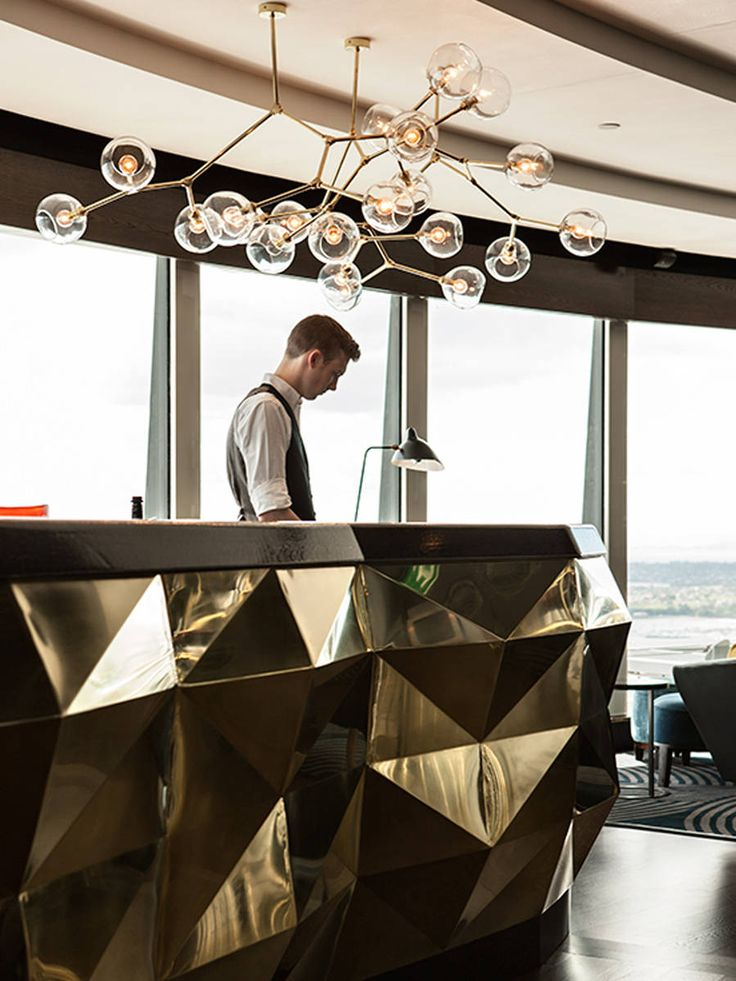 Sugar Club - Love the metal #facets on front desk. #lighting