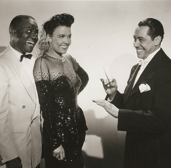 """Promotional still for the film Stormy Weather (1943) featuring Duke Ellington, Bill """"Bojangles"""" Robinson and Lena Horne."""