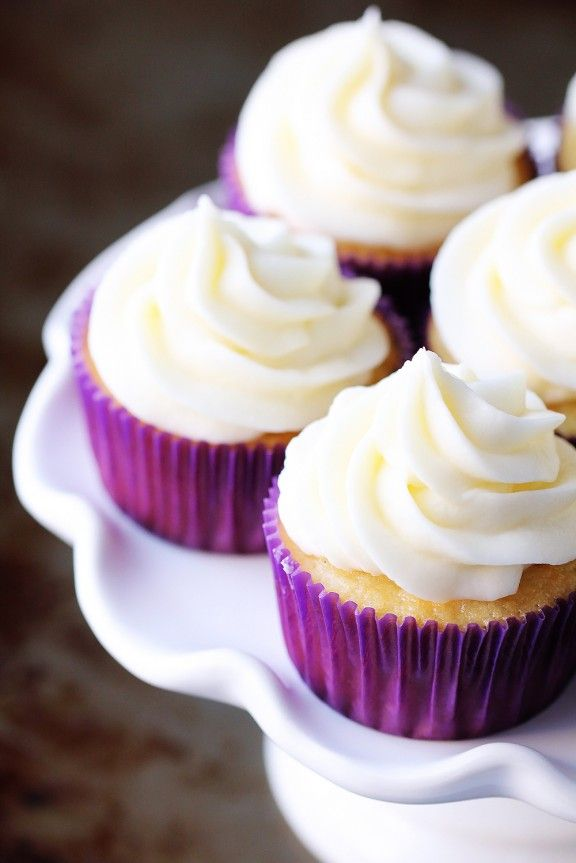 Favorite Vanilla Cupcakes with Vanilla Buttercream Frosting - gimmesomeoven.com - cupcake recipe uses Greek Yogurt or Sour Cream