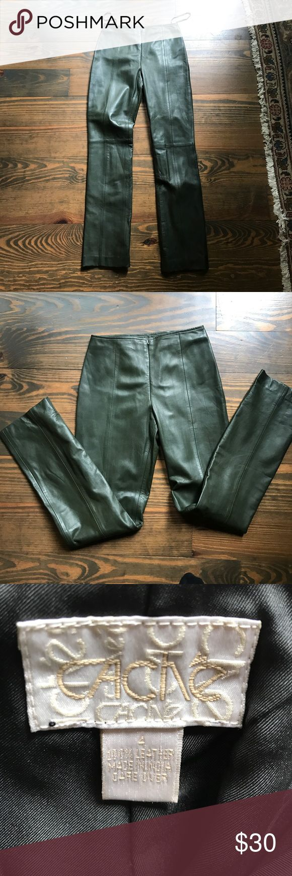 Forest green 💯 % leather pants CACHE' 100% genuine forest green leather pants. they have a zipper that's in the front they are marked a size 4 but I would say they fit a size 0....I'm a size 4 and cannot get them zipped (I weight 132). I am 5'5 and they come right below my ankles they have never been hemmed and only worn twice. Perfect condition! Cache Pants Straight Leg