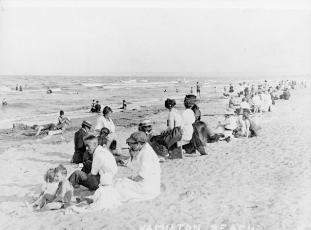 Swimmers and others on the Lake Ontario side of the Beach Strip. What a great pic!