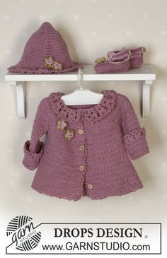 "BabyDROPS 14-5 by DROPS Design ""Romantic baby set for a little lady! Enchanting and cute with crocheted hat and young decorative flowers. A set that can be used for generations!"" The set comprises: Cardigan, hat and shoes."
