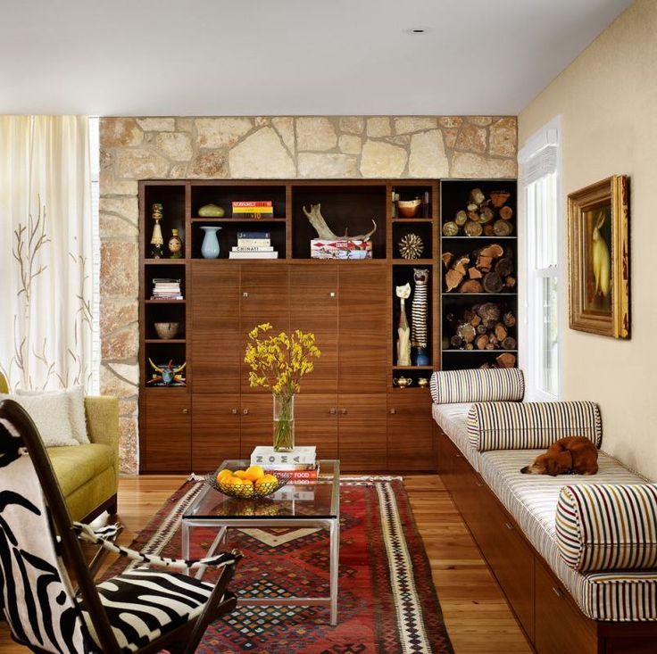 Living room - stone like background over the bookshelf and bench storage with cushions