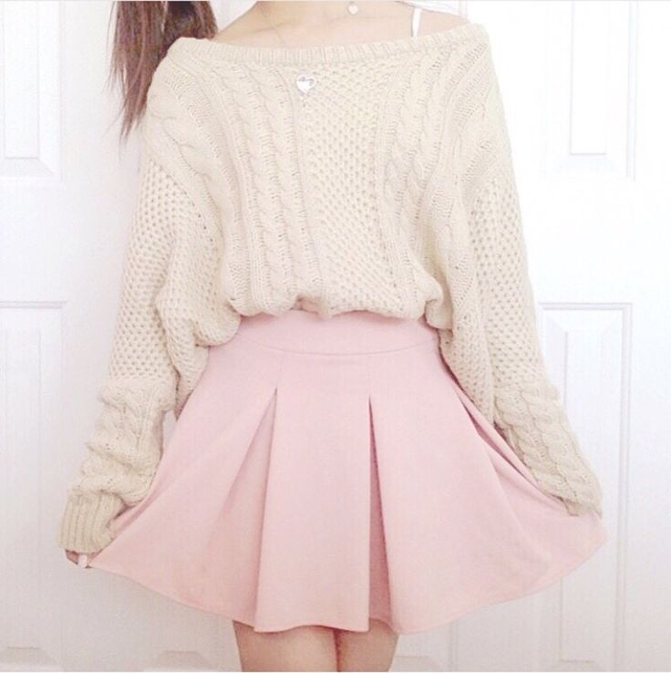 Cream sweater with a light pink skirt