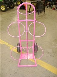 Show Feed Bucket Holder in bright pink. way easier then lugging buckets across the building now you have to just push it