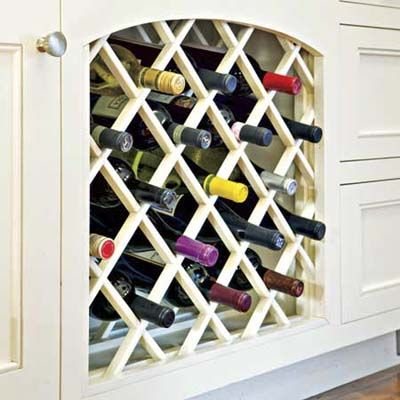 Wine storage built in under the counter keeps bottles at the ready (and corks moist) for entertaining. | Photo: John Ellis | thisoldhouse.com