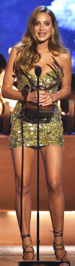 """Hannah Davis Nabbed the """"Our New Girlfriend"""" Title at the Guys' Choice Awards in a gold sequined Lorena Sarbu minidress and strappy Stuart Weitzman heels."""