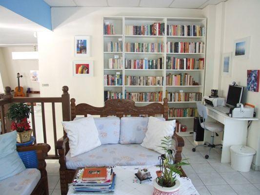 Daphne's Club living room library