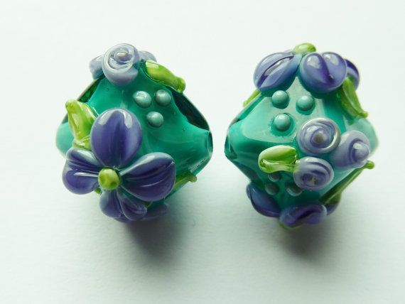 glass lampwork beads in teal with flower decoration