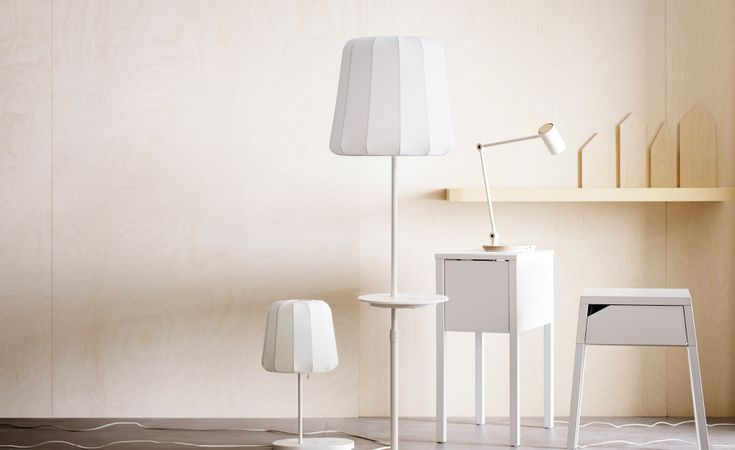 A display of lamps and bedside tables with wireless charging, coming soon from Ikea