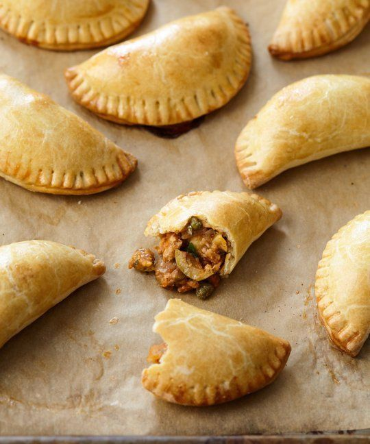 Chicken's versatility has earned it a place on the table at least once a week. And while a golden roast chicken will always be a classic favorite, and chicken breast maintain their claim to ease, heartier cuts like chicken thighs and blank-canvas options like ground chicken allow us to do even more with the bird. Doing more now includes making these hearty chicken empanadas.