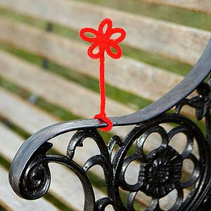 Random Acts of Art: Here's an instant way to add an eye-catching touch of brightness to an otherwise drab location. Bend colorful pipe cleaners into a flower, heart, or star shape or into a few squiggly spirals. Wind the ends around a park bench, a parent's car door handle, or a chain-link fence.