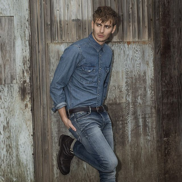 Original blue jeans with years of hard wear and tear. Blue denim on denim look, with a black belt and black leather boots | JACK & JONES