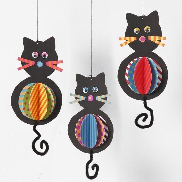 Cat shaped cardboard box pendant with colorful bellies and tails from pipe cleaners