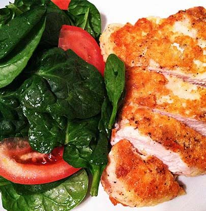 Is chicken boring you? I see chicken as a blank slate, desperately in need of a pulling, a shredding, a pounding, a battering, a sear, a roast or a glaze. Parmesan Crusted Chicken Breast is worth the time, effort and the use of two heat sources (stovetop and oven). You'll end up with a crisp cheesy crust on the outside and juicy meat on the inside. Serve with a fresh crunchy salad and you're good to go.