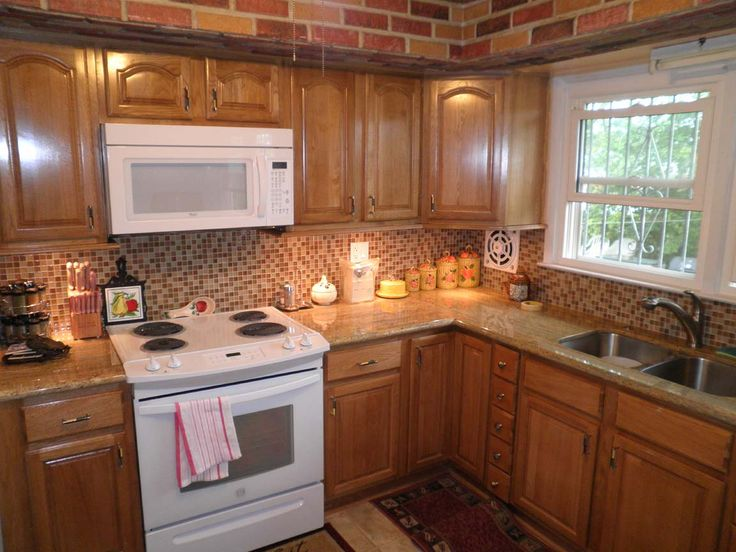 ADD WHITE TO BACKSPLASH TO BALANCE DARK CABINETS WITH WHITE APPLIANCES/ADD FAN OVER STOVE